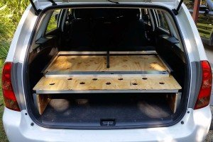 Rear view folded up Corolla wagon camper conversion